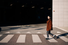 Portrait Of Woman Crossing Road