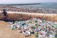 Plastic Bottles By Retaining Wall Against Beach