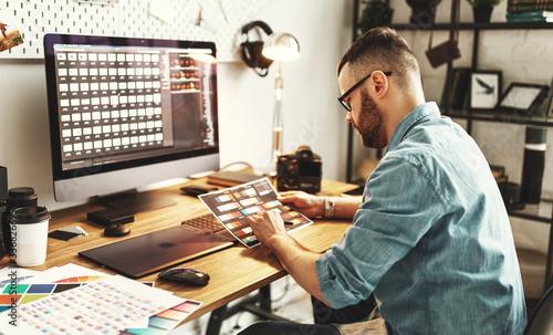 Fotografie, Obraz Modern designer working in home office