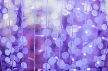 Defocused Image Of Purple Christmas Lights