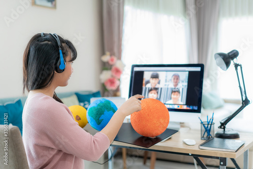 Asian woman teacher teaching solar system via video conference e-learning and cheerful elementary school student looking at globe, Homeschooling and distance learning ,online ,education and internet Canvas Print