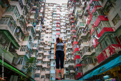 Photo Traveler Exploring Densely Populated Housing Apartments in Hong Kong