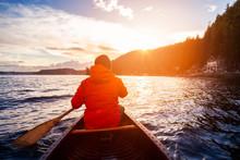 Adventurous Man On Wooden Cano...