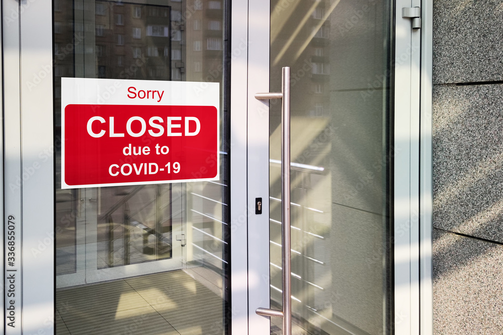 Fototapeta Business center closed due to COVID-19, sign with sorry in door window. Stores, restaurants, offices, other public places temporarily closed