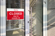 Business center closed due to COVID-19 coronavirus, sign with sorry in door window. Stores, restaurants, offices, other public places temporarily closed