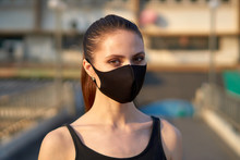 Woman Wears A Black Mask To Pr...