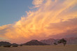 Leinwandbild Motiv Namib desert landscape at sunset with rugged mountains and dramatic clouds, Namibia.