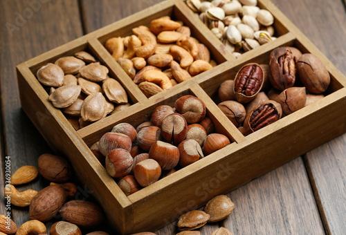 Valokuva Various nuts in wooden box