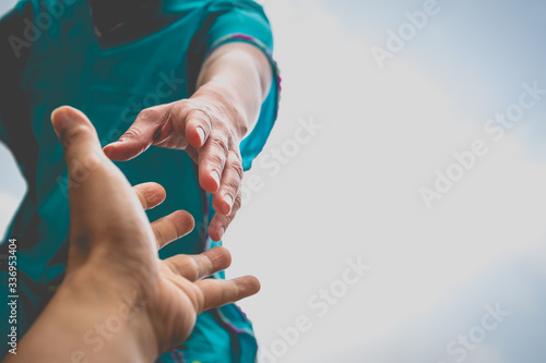 Fotografía Help Concept hands reaching out to help each other.