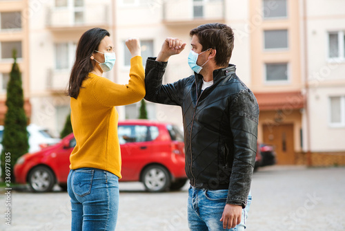 Young couple greeting with elbows Tableau sur Toile