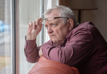 Nosy Neighbor Looking At Something Out Of His Window