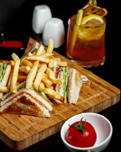 Club Sandwich With Fries And Single Tomato