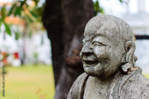 Fotografie, Obraz Buddha Statue in Marble temple Bangkok with blurred background
