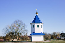 A Small White Christian Chapel With A Blue Roof. The Building Of The Russian Orthodox Church.