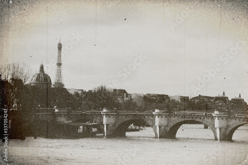 Fototapeta Vintage photo effect, grunge and film defects. The view of the old bridge in the centre of Paris , the Seine river and visible from afar the top of the Eiffel tower. obraz na płótnie
