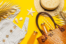 Beach Wicker Straw Rattan Women's Eco Bag White Dress Hat Golden Tropical Leaf Juice In Glass Jars Straws Shells Starfish On Yellow Background. Flat Lay Top View. Summer Background Beach Accessories