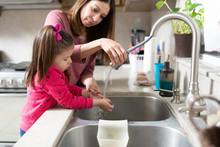 Little Girl Washing Her Hands ...
