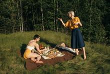 Girlfriends Resting On Meadow ...