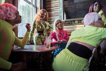 Group Of Drag Queens Hanging Out In A Bar