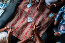 Crop People Playing Cards In T...