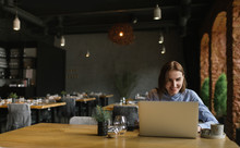 Smiling Woman With Laptop In M...