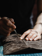 Close Up Of A Leather And Hands Of A Craftsman. Detail Of A Handmade Process