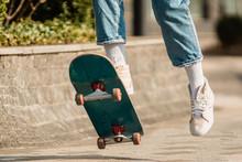 Skateboarding At City. Female,...
