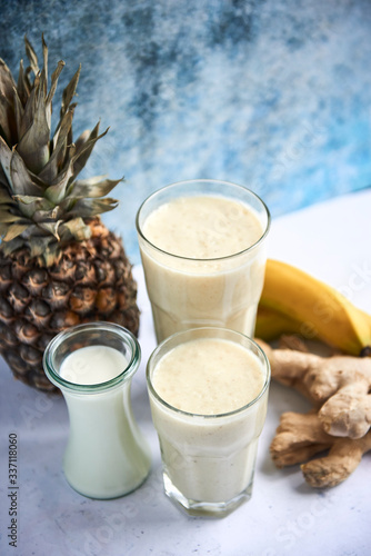 Fototapeta White smoothie with banana, pineapple and ginger obraz