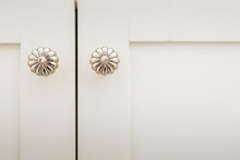 Decorative Silver Door Knobs On White Cabinet Doors
