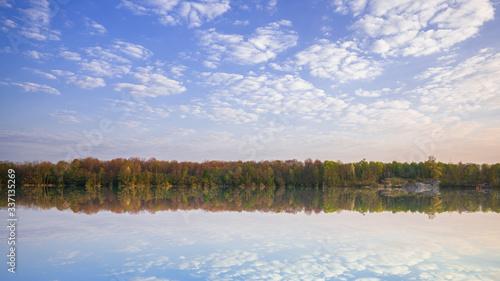 Vászonkép Amazing reflection at a dredging lake near Rastatt Ottersdorf