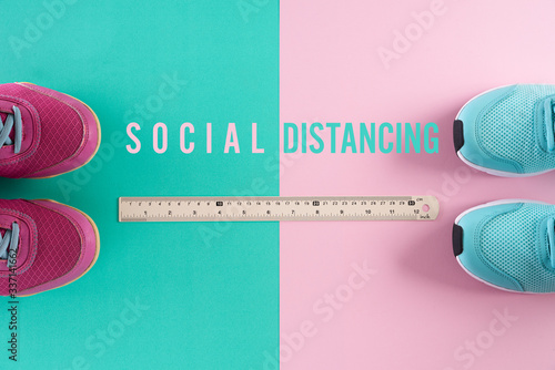 Fototapeta Social Distancing concept. shoes with ruler on green pink pastel background by far from other by using social distancing concept to stop the coronavirus from spreading. obraz