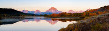 Panorama Of Fall Color In Front Of The Grand Teton Range And Mt. Moran At The Oxbow Bend Of The Snake River At Sunrise