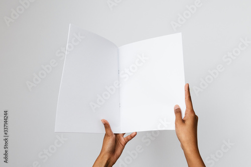 Fotografía Woman of color holding a blank letter-sized or A4 mockup.