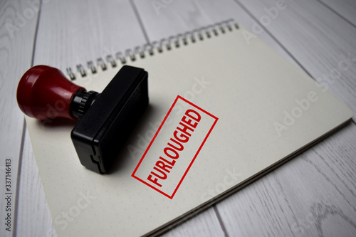 Fotomural Red Handle Rubber Stamper and Furloughed text isolated on White Background