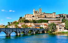 Pont Vieux Over Orb River Against Beziers Cathedral On Sunny Day