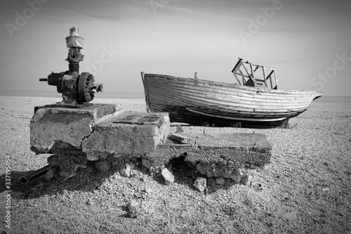 Fotografie, Obraz Abandoned Boat Moored At Beach Against Sky