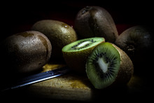 Close-up Of Kiwis On Table In ...