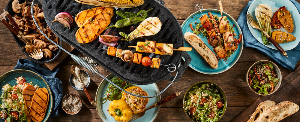 Fototapeta Vegetarian barbecue grilled dishes on timber table