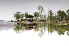 Gazebo By Lake Against Sky