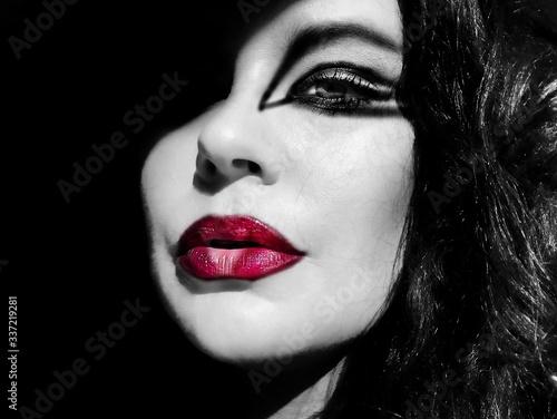 Fototapeta Sunlight Falling On Young Woman With Red Lipstick In Darkroom obraz na płótnie