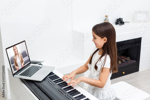 Scene of piano lessons online training or E-class learning while Coronavirus spread out or covid-19 crisis situation, vlog or teacher make online piano lesson to teach students pupils learn from home Fototapeta