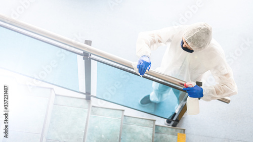 Photo rail disinfection - surface cleaning after coronavirus pandemic