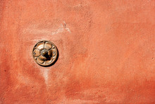 Close-up Of A Brass Old Doorbell On A Red Wall With Copy Space. Tellaro Village, Liguria, Italy, Europe