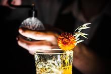 Golden Shimmering Whisky In Gl...