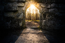 Ancient Archway With Sun In Th...
