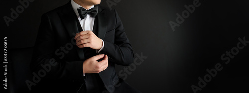 Papel de parede Close up of man who is arranging his black suit