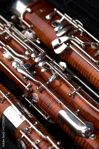 Wooden bassoon isolated on a black background. Music instruments. Canvas Print
