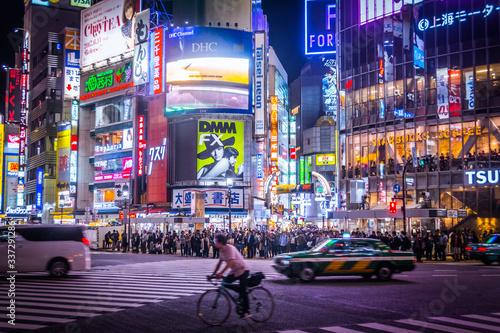 Fototapeta Illuminated Commercial Signs On Buildings At Shibuya obraz