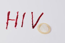 Hiv Text With Condom Over White Background