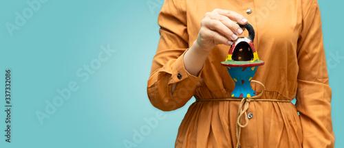 Valokuva closeup woman holding small clay decorative Arabian Bakhoor incense burner cense